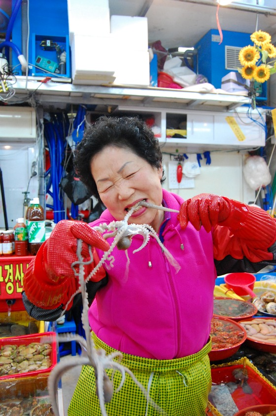 Woman eating raw octopus